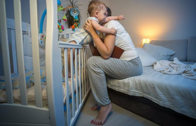 How do you get a newborn to sleep in a bassinet?